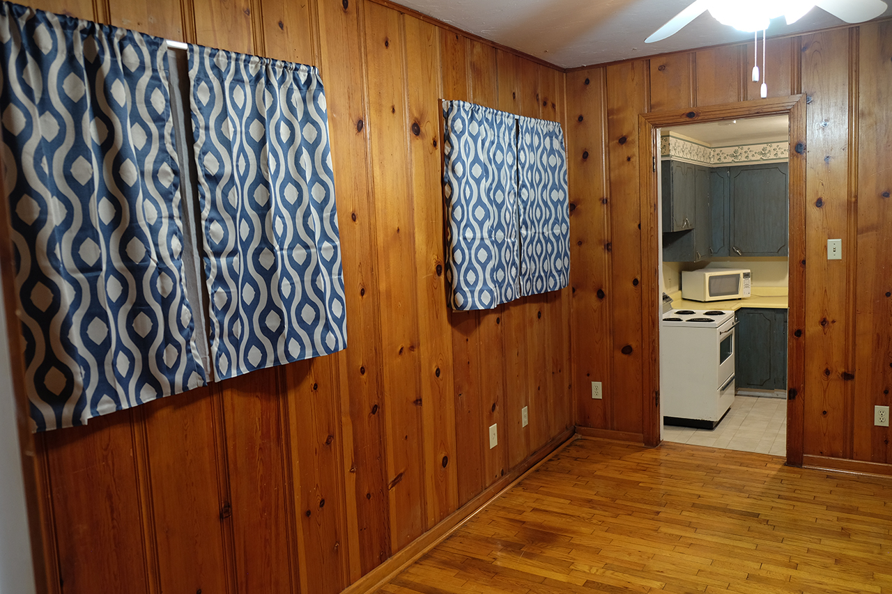 West living room and view into west kitchen - 102 South Kings Rent House